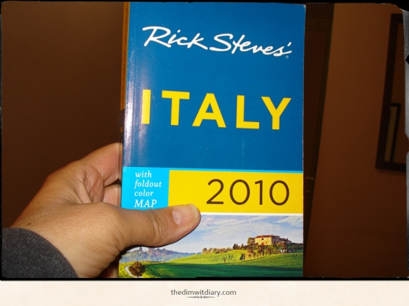 001 My Mom taking a picture of a Italy tour book